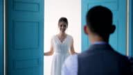 Beautiful bride goes to beloved in wedding dress video