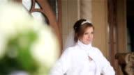 Beautiful bride in a wedding dress posing video