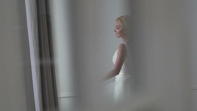 Beautiful bride posing in her wedding dress video