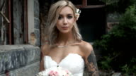 Beautiful bride with tattoos video