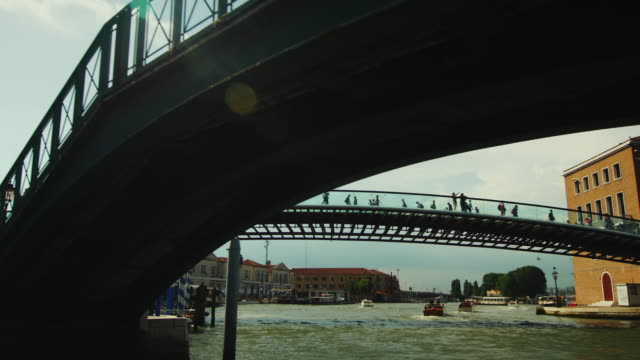 Beautiful bridges of Venice. Swim under the bridge, the sun shines beautifully with glare. Great vacation in Venice video