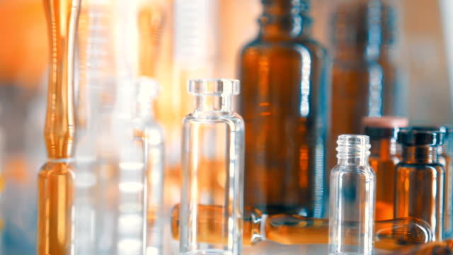 Beautiful, brilliant, colorful, empty glass bottles, ampoules and vials video