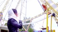 Beautiful brunette girl looking at observation wheel video