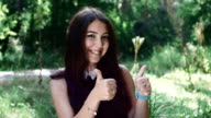 beautiful brunette girl showing thumbs up video
