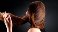 Beautiful brunette tossing her long hair video