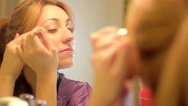 Beautiful Brunette Young Woman Applying Make Up video