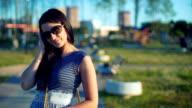 Beautiful brunette young woman posing outdoors video