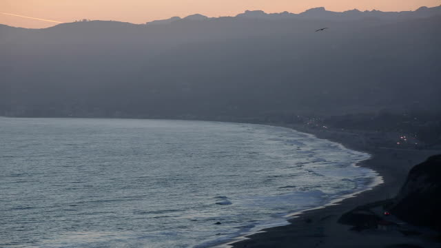 Beautiful California Beach and the Pacific Ocean.  Malibu Beaches just after Sunset. Pelicans flying by. video