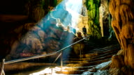 Beautiful cave entrance with sun beam video