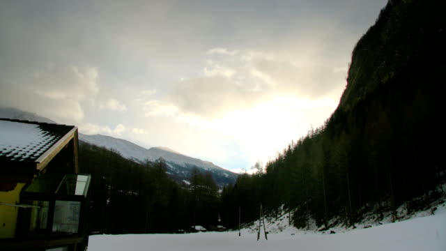 Beautiful clouds and Austrian ski chalet video