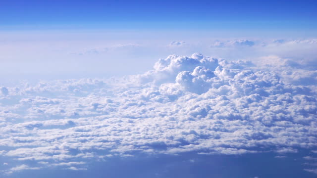AERIAL Beautiful clouds in blue sky taken from airplane video