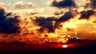 Beautiful cloudscape with large, building clouds and sunrise breaking through cloud mass. video
