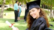 Beautiful college graduate in wheelchair proudly holds her diploma video