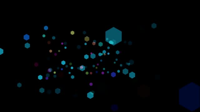 Beautiful Colorful Bokeh Hexagons Falling on a Black Background video