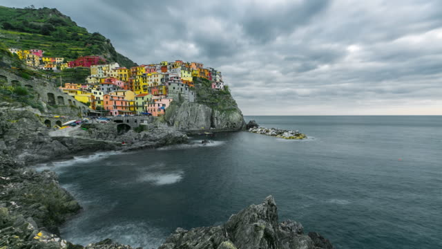 Beautiful colorful cityscape on the village of manarola, Cinque Terre coast at sunset, Italy video