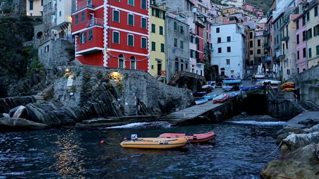 Beautiful colorful cityscape on the village of Riomaggiore, Cinque Terre coast in Italy. video