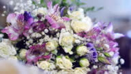 beautiful colorful flowers are on table. bouquet of white, purple and red flowers on table. video