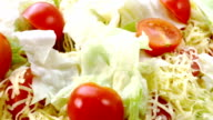 Beautiful colourful caesar salad with dressing croutons and parmesan cheese, healthy meal video