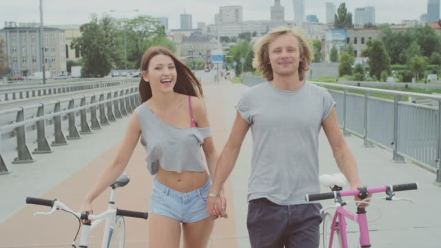 Beautiful couple cycling in the city video