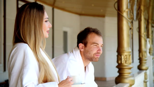 Beautiful couple relaxing in a hotel. Drink tea video