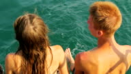 beautiful couple relaxing on a yacht video