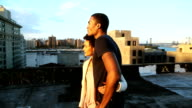 Beautiful couple stand and look at city scape video