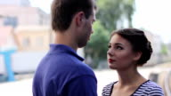 Beautiful couple talking at the railway station video