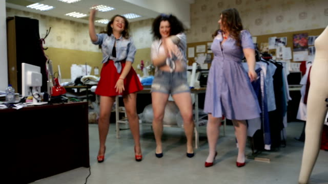 Beautiful curvy female models imagined as pinup seamstresses at a clothing workshop video