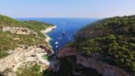 AERIAL Beautiful Dalmatian bay Stiniva on Vis island video