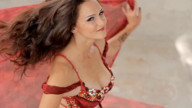 Beautiful dancer of oriental dance spinning video