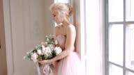 Beautiful, delicate and feminine bride. Wedding bouquet of roses. video