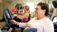 Beautiful diverse senior women work out at senior center video