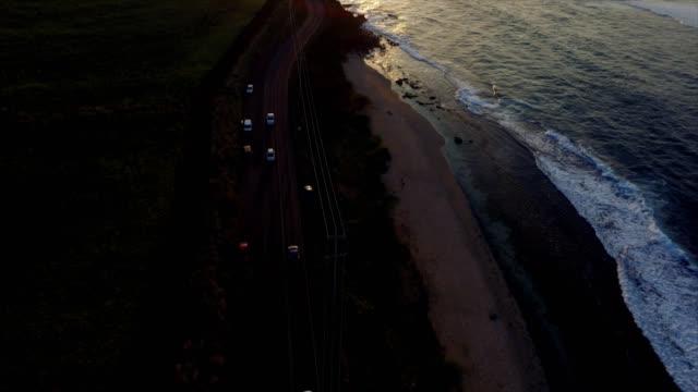 Beautiful drone shot reveal of Maui coastline as the sun is setting video