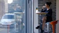 Beautiful, elegant businesswoman on coffee breake video