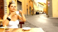 Beautiful fashion woman drinking coffee in italian outdoors cafe video