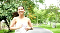 Beautiful Female Athletic Running in the park Slow Motion video