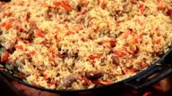 Beautiful (making you salivate intensively) footage of a pilaf being cooked video