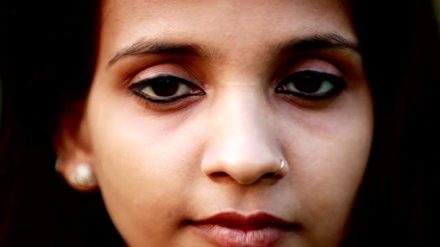 Beautiful girl blinking eyes video