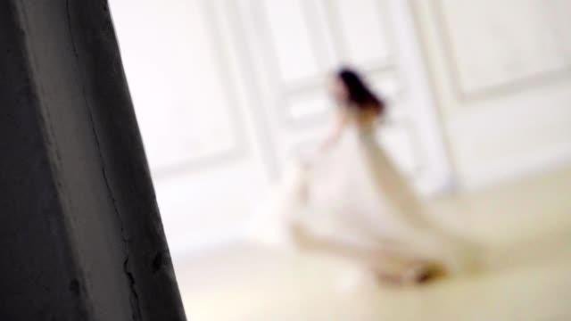A beautiful girl dances in long evening dress video