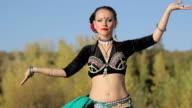 Beautiful  girl dancing exotic dance on nature video