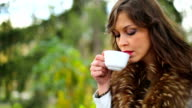 Beautiful Girl enjoy a coffee in Nature video