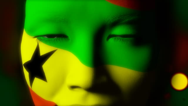 Beautiful girl Ghana flag face painted video