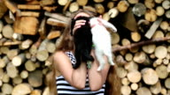 Beautiful girl holds in hands two little kittens video