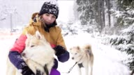 Beautiful girl hugging the dog. The girl with the siberian husky video