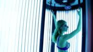 Beautiful girl in swimsuit at solarium video