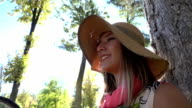 Beautiful girl in the park under tree video