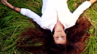Beautiful Girl Lying on the Meadow and Dreaming. Enjoy Nature. Eyes Closed video