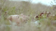 Beautiful girl lying on the meadow video