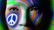 Beautiful girl PEACE symbol face painted video