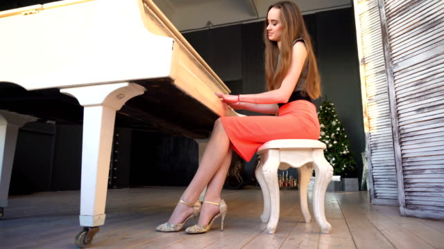 Beautiful girl playing on the grand piano video